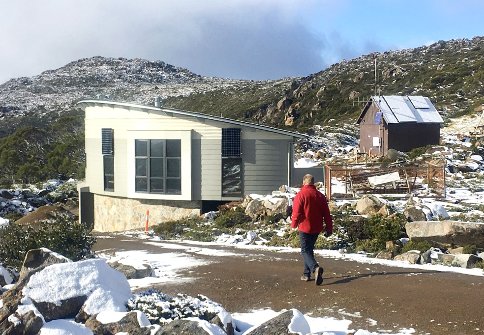 Mt Mawson Day shelter external view walking man in red jacket